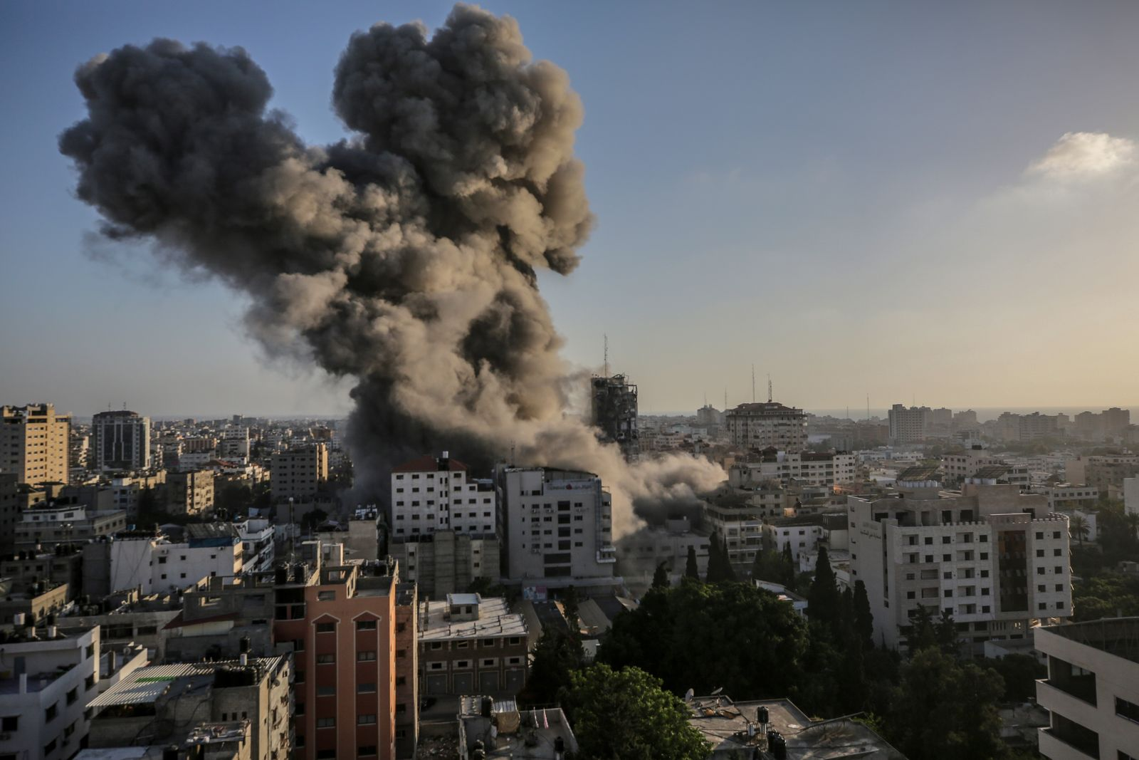 Smoke and flames rise after an Israeli strike Al-Shorouq tower in Gaza City
