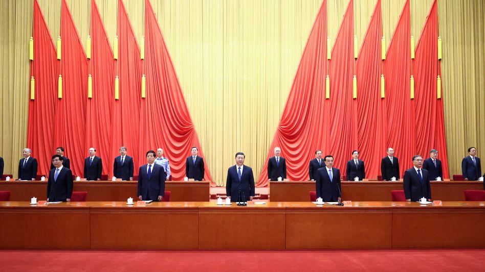 Chinesische Regierungsmitglieder bei einem Kongress: Streben nach »Frieden und gutem Essen«