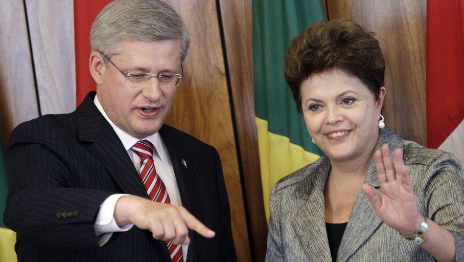 Kanadas Premier Harper, Brasiliens Präsidentin Rousseff: Irritationen in Brasília?