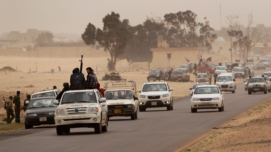 Libyan rebels retreating from Ajdabiya on Thursday.