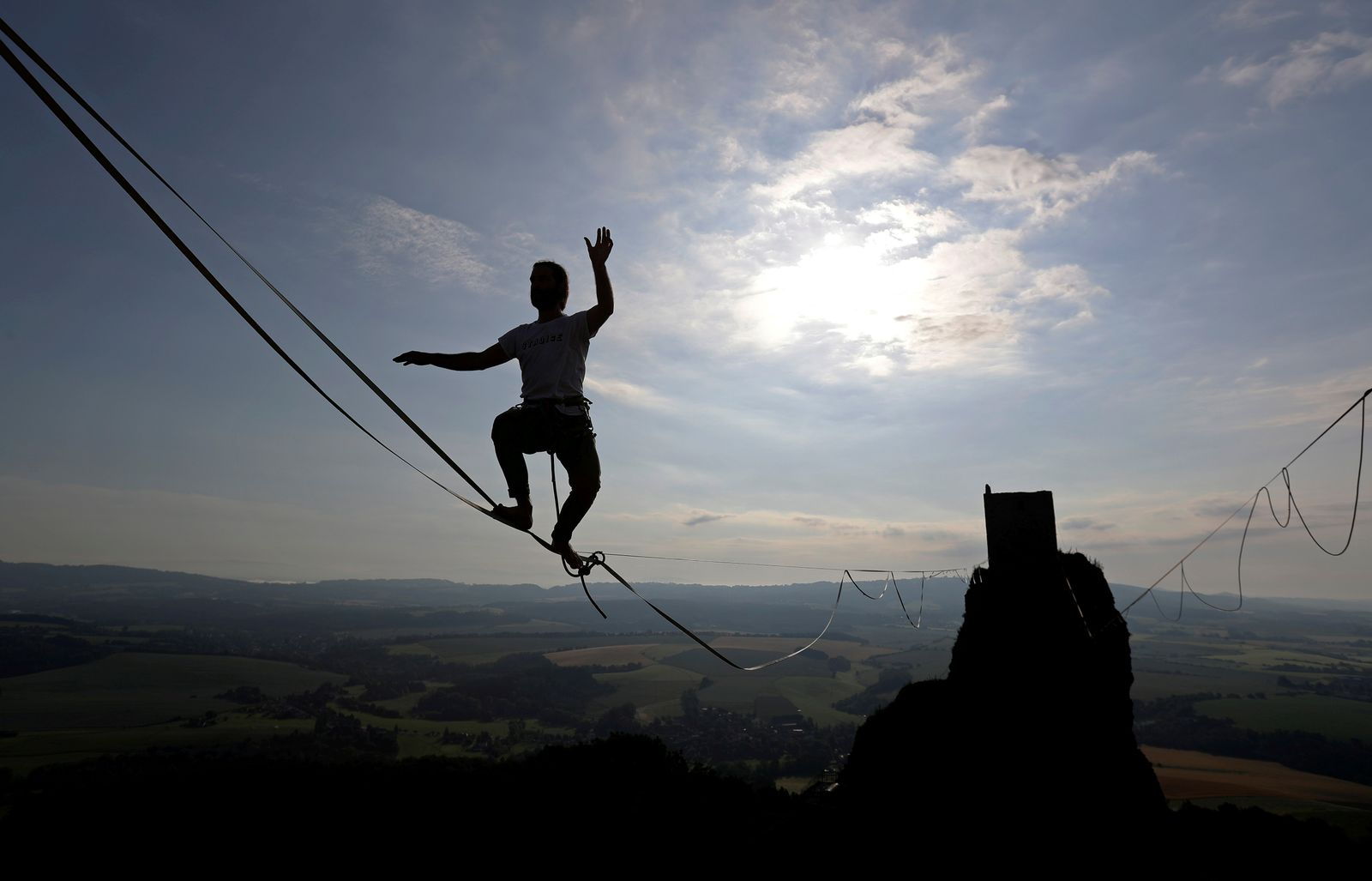 A participant balances on the line at the Trosky Castle near the town of Turnov