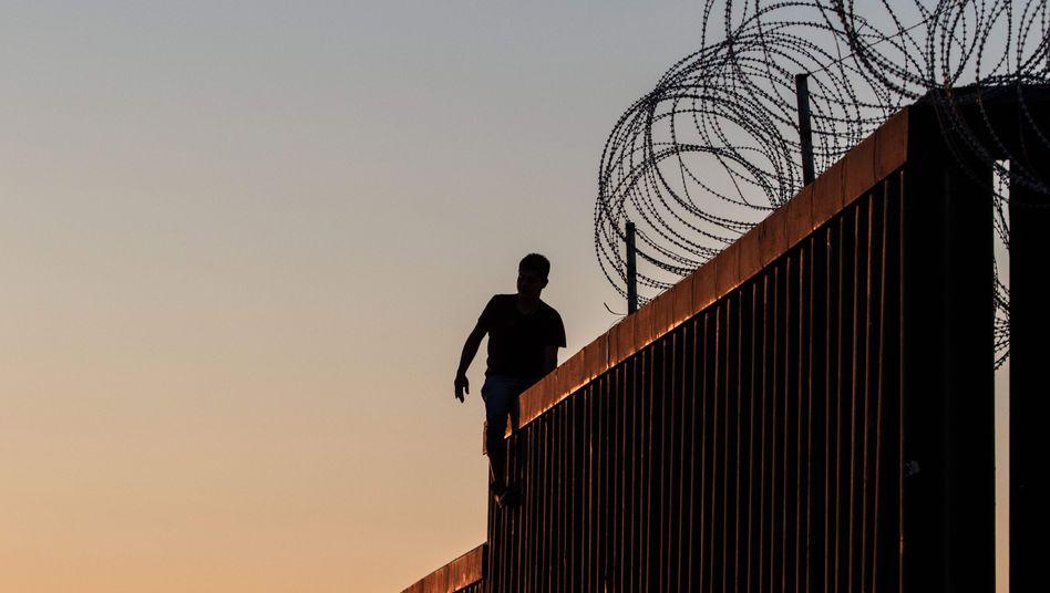 Einwanderer an der Grenze zwischen den USA und Mexiko
