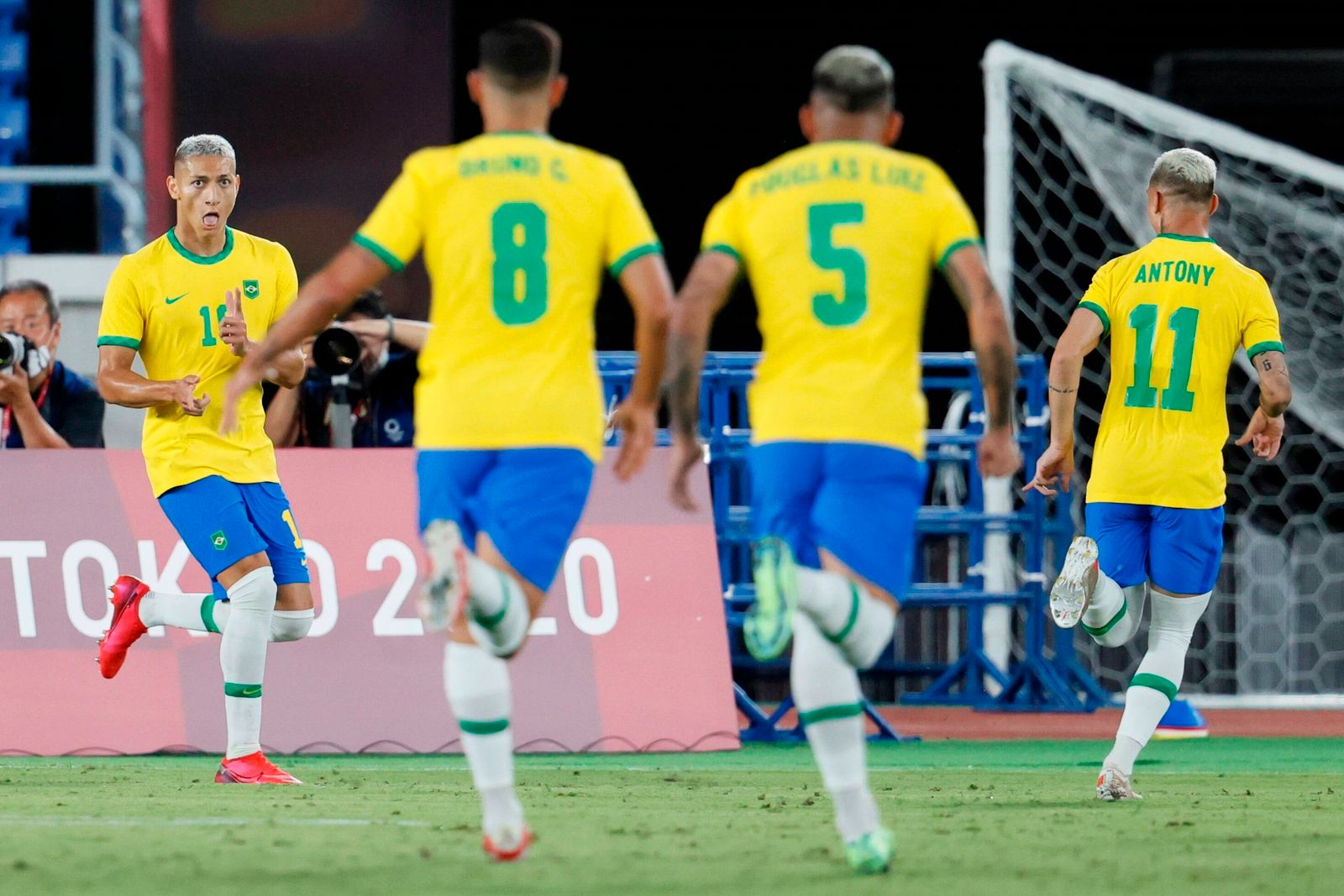 Brazil s striker Richarlison (L) celebrates with his teammates after scoring the 2-0 during the men s soccer Group D so