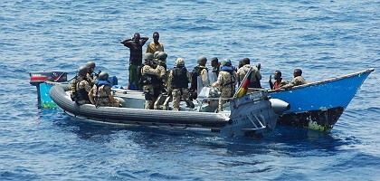 Here, German navy sailors can be seen arresting the suspected pirates on March 3.