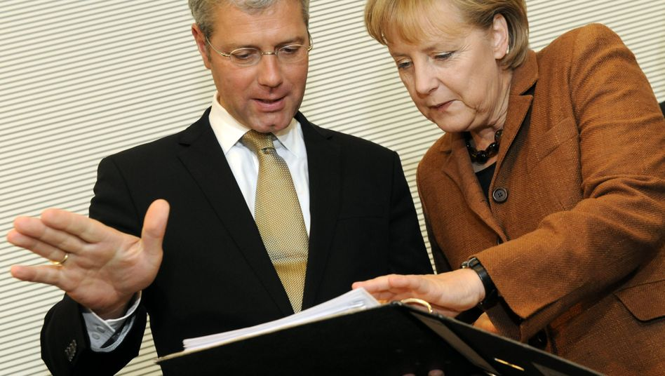 German Environment Minister Norbert Röttgen with Chancellor Angela Merkel.