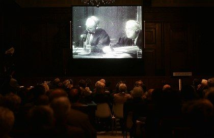 The proceedings of the Nuremberg Trials are projected on a screen during the 60th anniversary ceremony commemorating the first major effort at international justice.