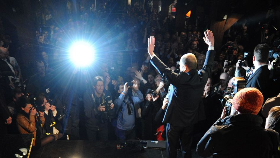 The SPD's leading candidate, Olaf Scholz, celebrates his victory on Sunday evening.