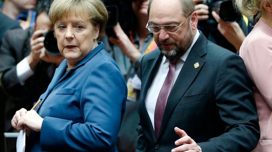 Gerangel hinter den Kulissen: Kanzlerin Merkel sieht den Machthunger von SPD-Mann Martin Schulz skeptisch.