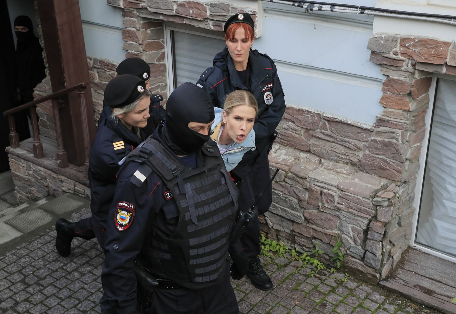 Law enforcement officers detain Russian opposition figure Lyubov Sobol near her office in Moscow