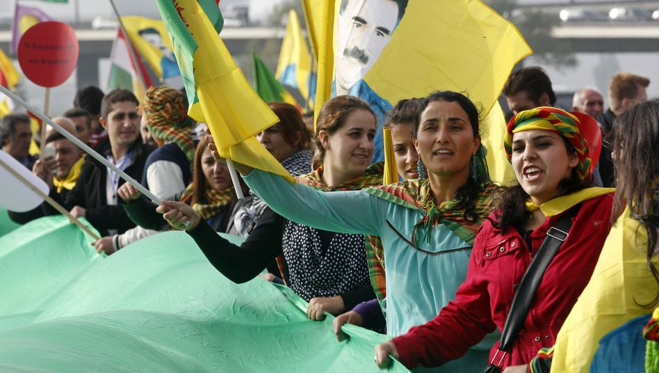 Kurds in Düsseldorf, Germany, demonstrate against Islamic State and show their support for besieged Kobani.
