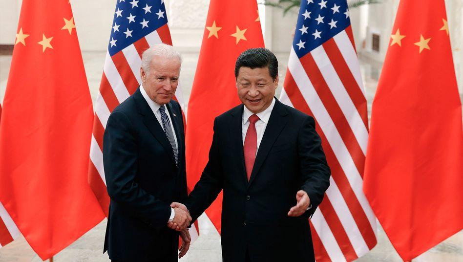 Alte Bekannte: Der damalige US-Vizepräsident Joe Biden mit Chinas Staatspräsident Xi Jinping im Jahr 2013