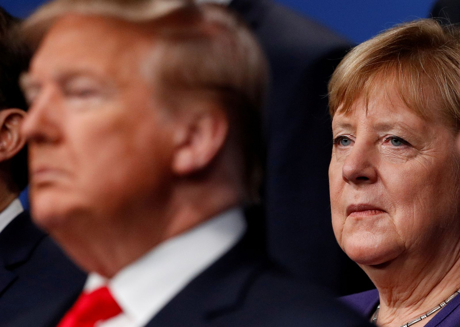 FILE PHOTO: U.S. President Donald Trump and Germany's Chancellor Angela Merkel pose for the family photo during the annual NATO heads of government summit at the Grove Hotel in Watford