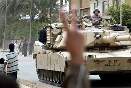 Fröhliche Begrüßung von US-Truppen in Bagdad: Die Euphorie ist verflogen