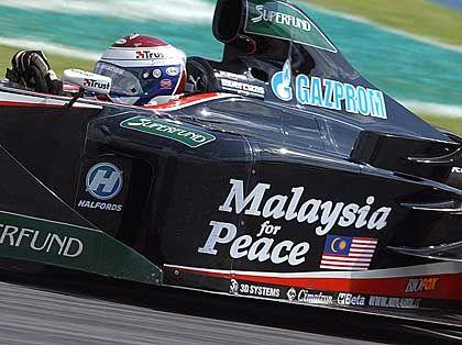 Friedensfahrt: Das Minardi-Team war beim Großen Preis von Malaysia mit einer besonderen Botschaft unterwegs