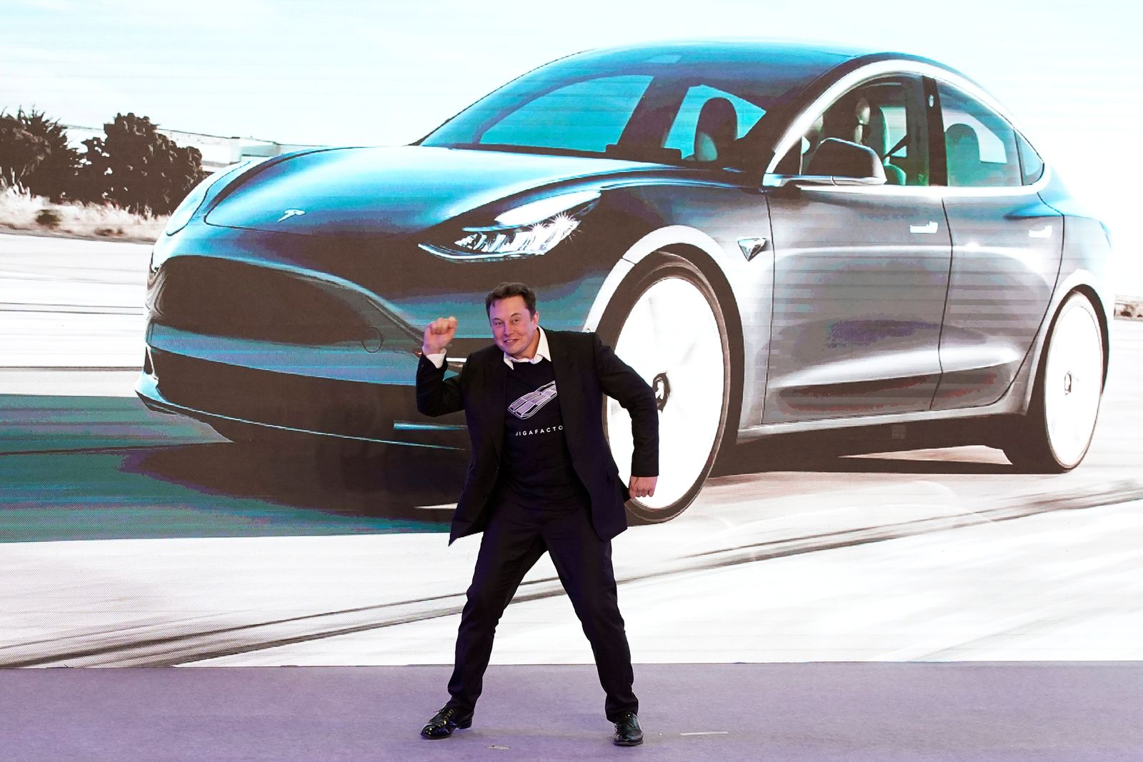 Tesla Inc CEO Elon Musk dances onstage during a delivery event for Tesla China-made Model 3 cars in Shanghai