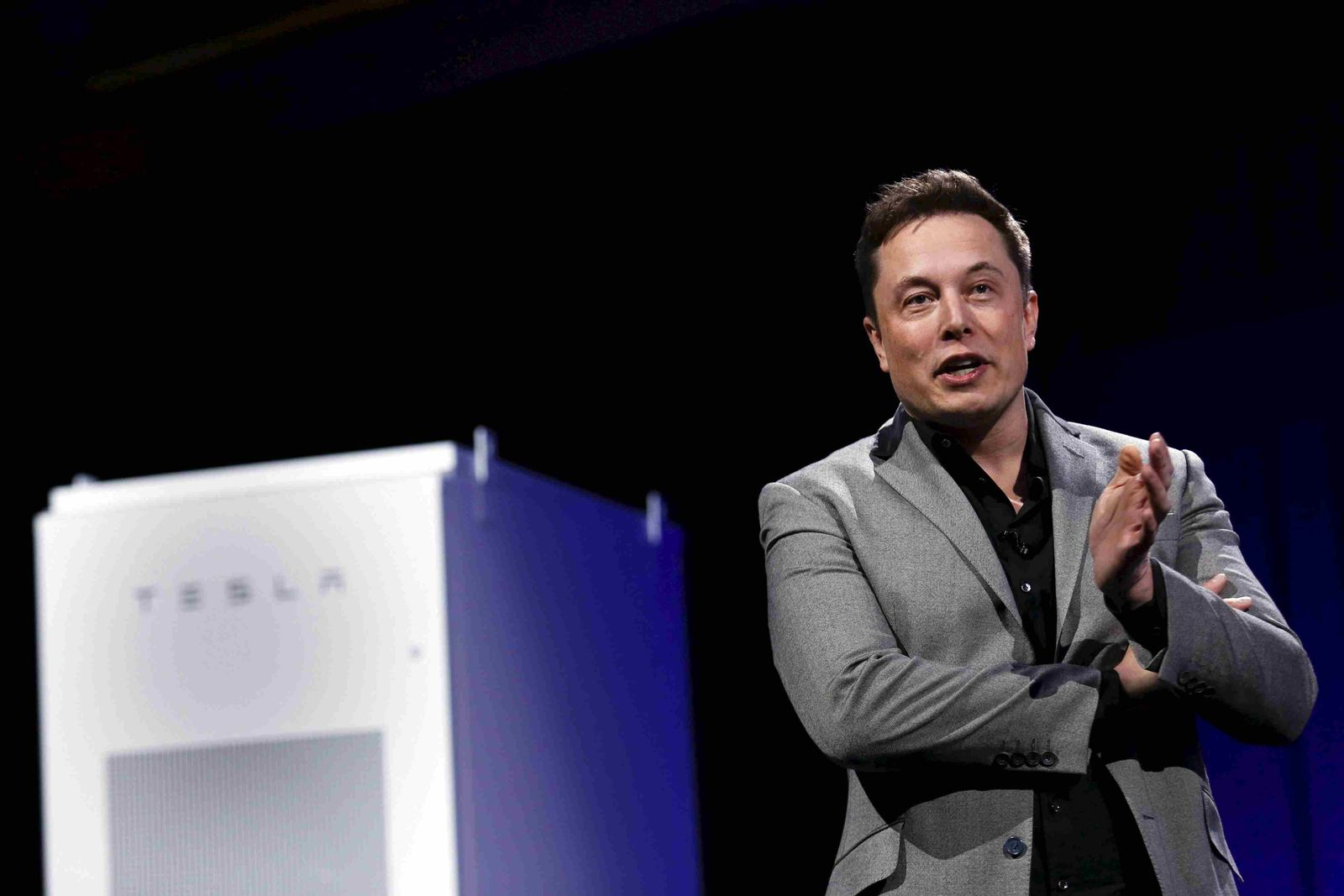 File photo Tesla Motors CEO Elon Musk reveals the Powerwall Home Battery during an event in Hawthorne, California