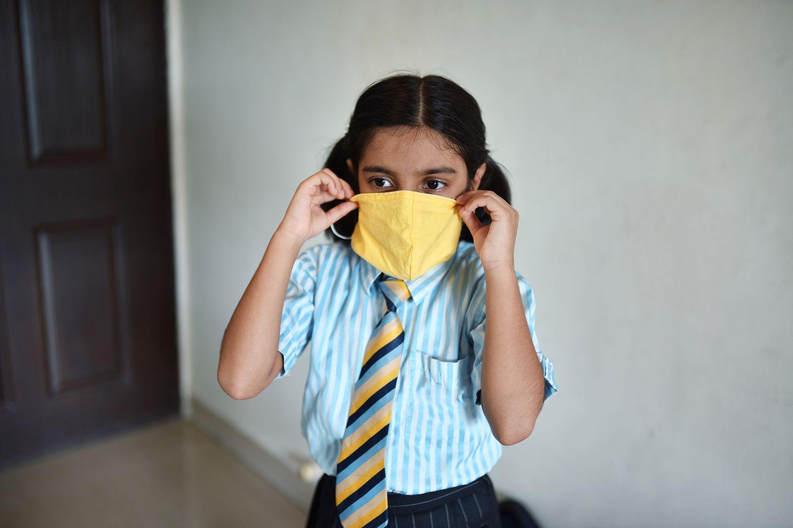 Portrait of a school girl wearing face mask