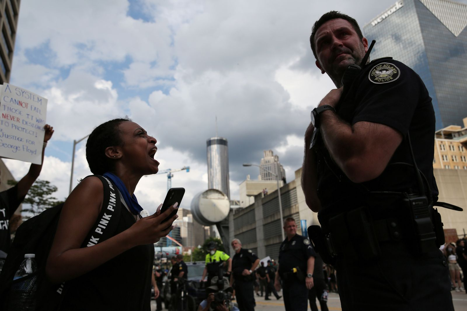 A woman yells at a cop during a protest in Atlanta
