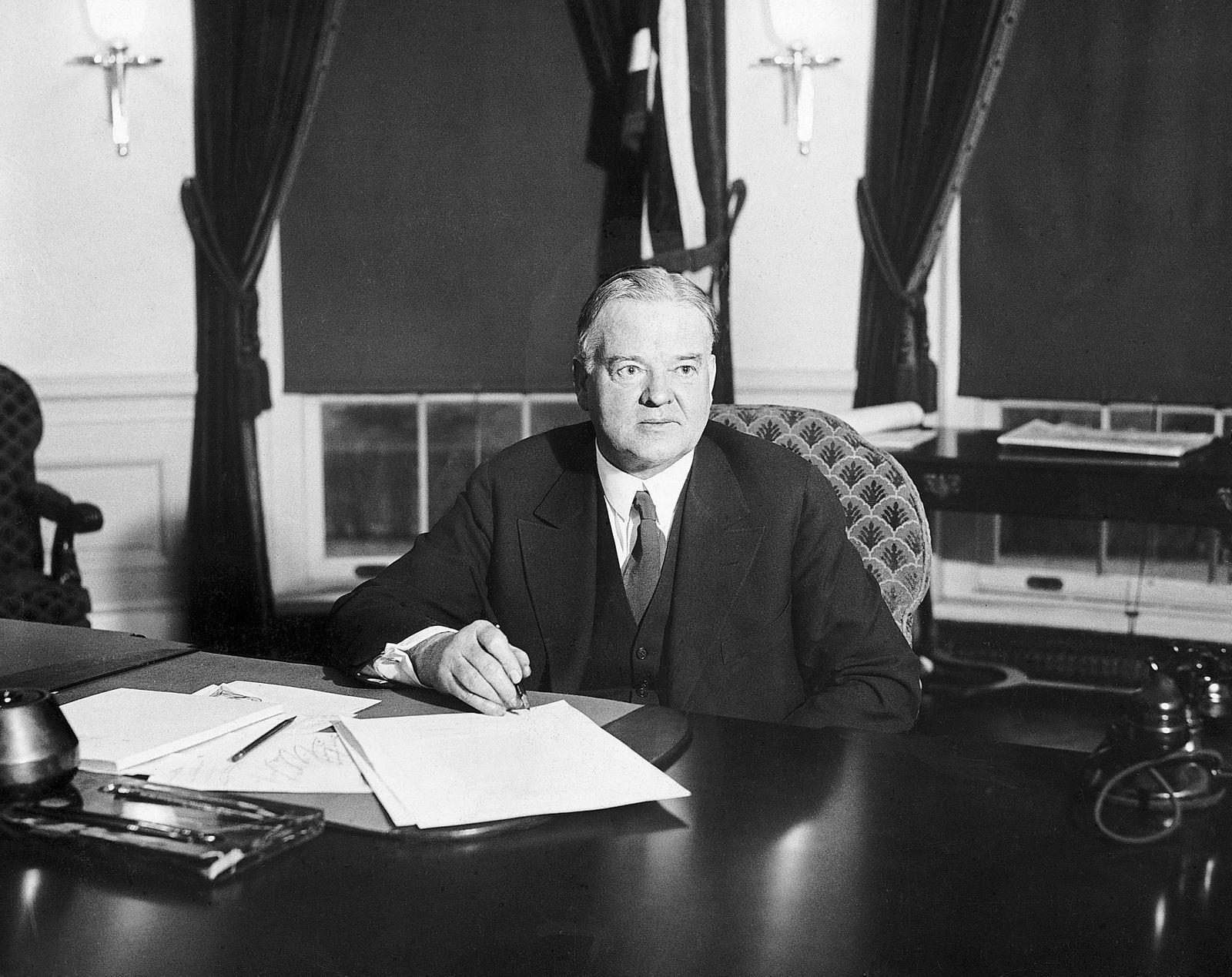 Herbert Hoover Signs Paper At Desk