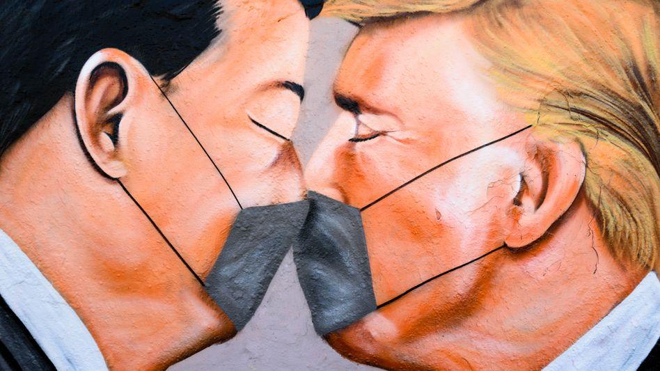 Graffito der Staatschefs von China und den USA, Xi und Trump:Peking nutzt die Gunst der Stunde