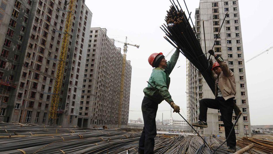 Bauarbeiter in der Provinz Shanxi: Euro-Krise könnte Chinas Boom beenden