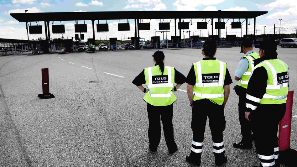 Danish customs officials stand ready at the Danish border to Sweden.