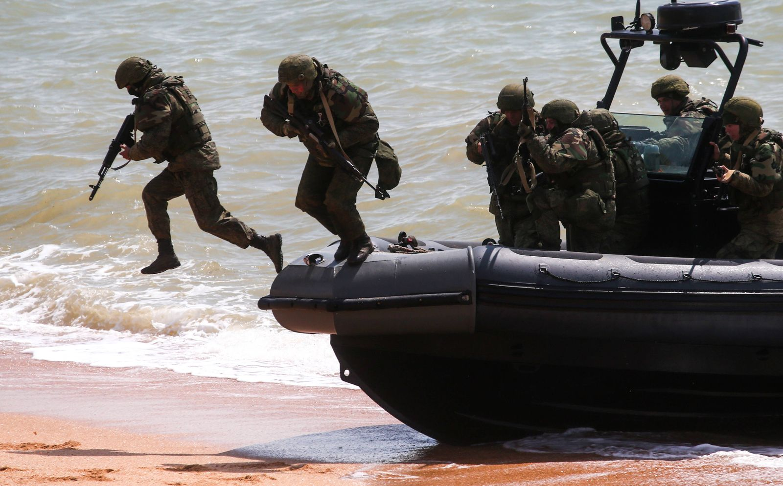 CRIMEA, RUSSIA APRIL 22, 2021: A Naval assault group disembark from a BK-10M fast assault boat during an exercise by