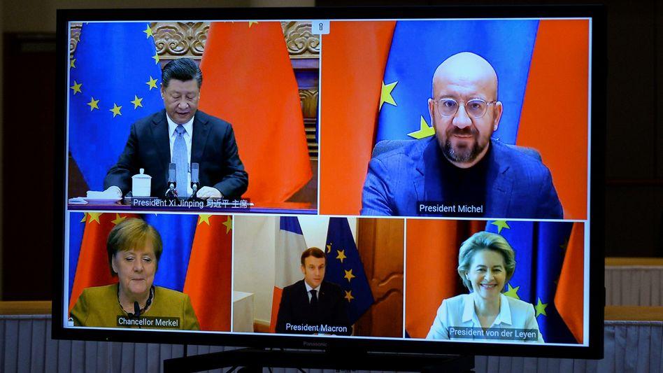 A screen shot of a Dec. 30, 2021, video summit including Chinese President Xi Jinping, European Council President Charles Michel, German Chancellor Angela Merkel, French President Emmanuel Macron and European Commission President Ursula von der Leyen.