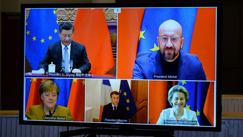 A screen shot of a Dec. 30, 2021, video summit including Chinese President Xi Jinping, European Council President Charles Michel, German Chancellor Angela Merkel, French President Emmanuel Macron and European Commission President Ursula von der Leyen.