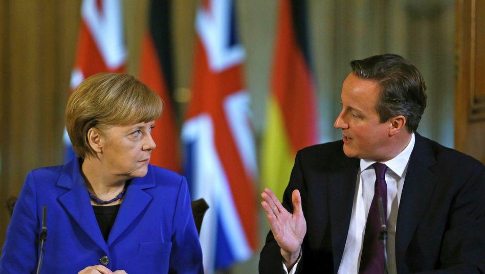 Merkel, Cameron (Archivbild): Austritt der Briten aus der EU befürchtet