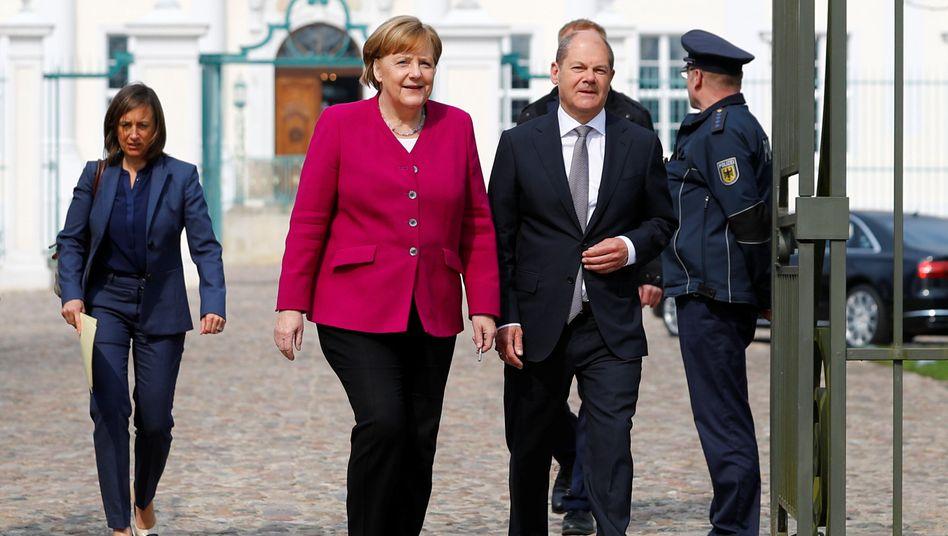 Angela Merkel und Olaf Scholz