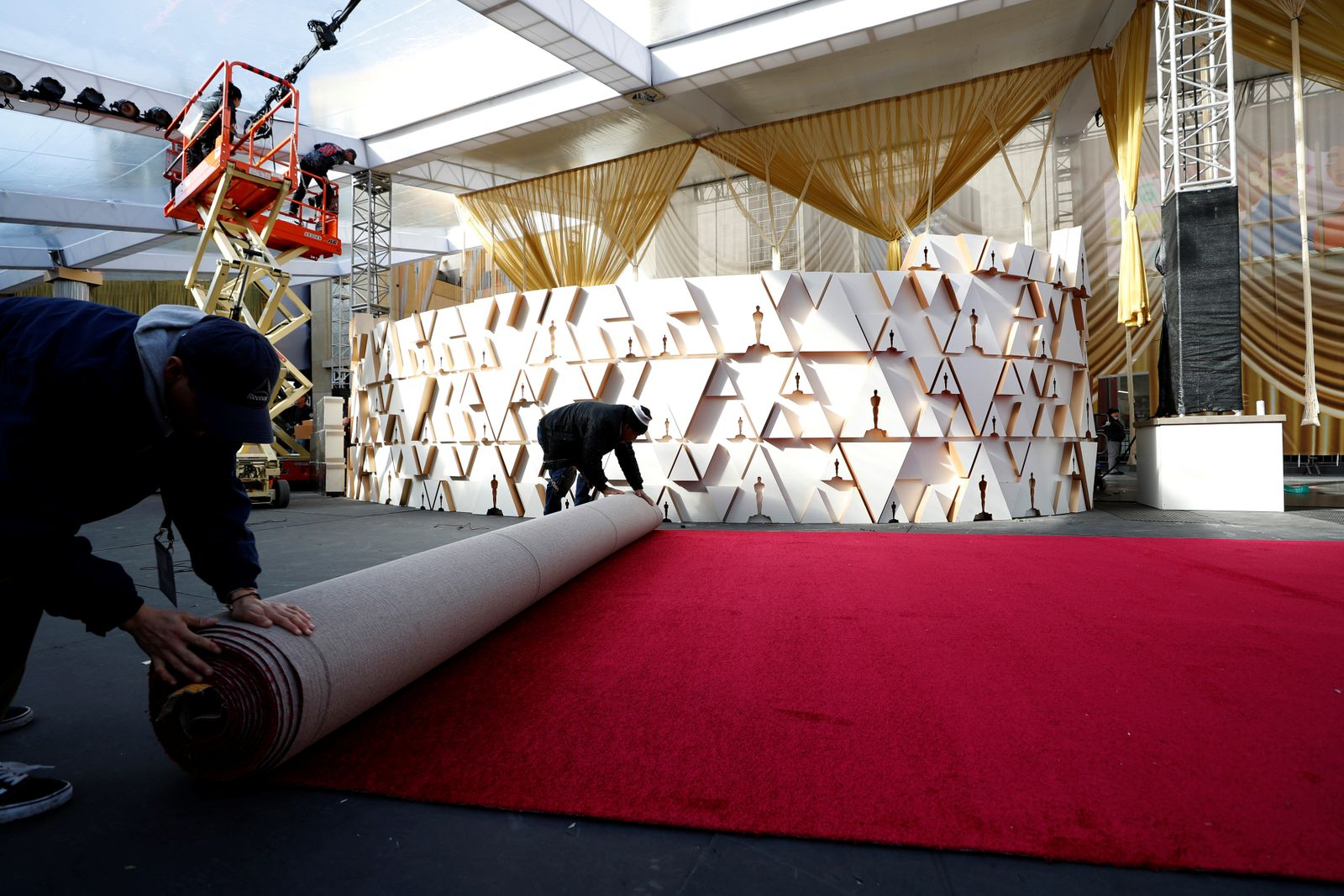 Workers set up the red carpet area in preparation for the 92nd Academy Awards outside Dolby theatre in Los Angeles