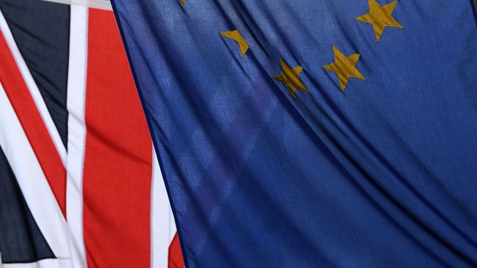 """The Union flag is draped behind that of the EU: """"All this doesn't make us somehow un-European."""""""