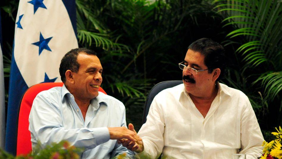 Friedenschluss unter Widersachern: Honduras Präsident Lobo (links) mit Vorgänger Zelaya