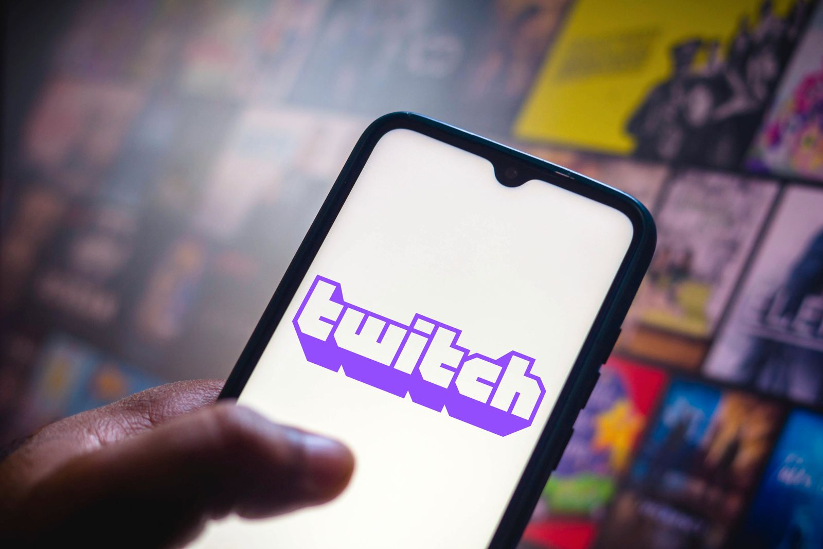 In this photo illustration the Twitch logo seen displayed on