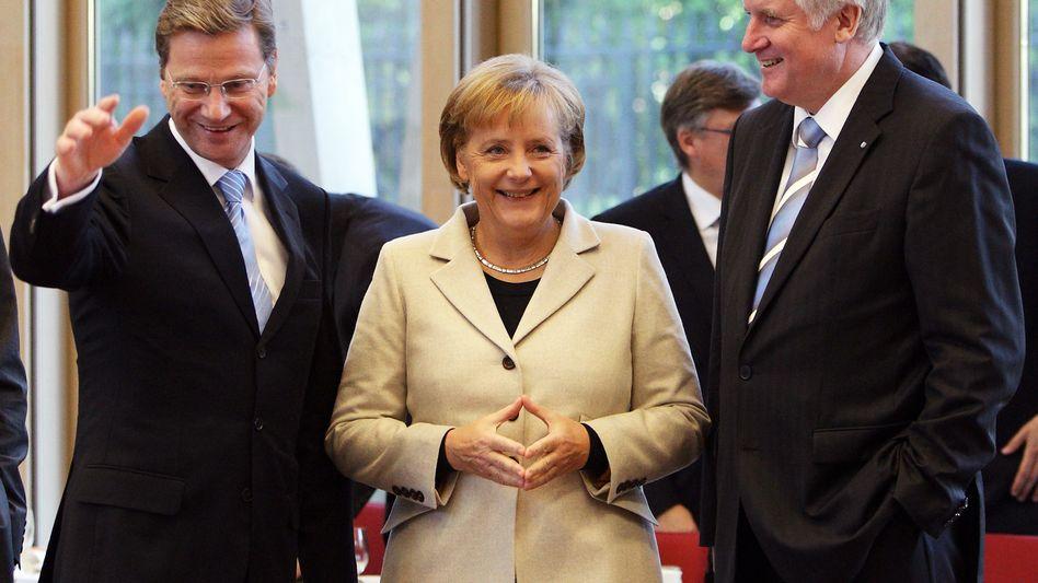 Westerwelle, Merkel und Seehofer: Bloß nicht dem Wähler wehtun