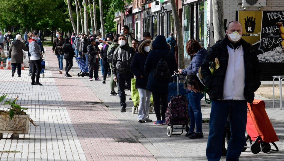 Residents waiting in line at a food bank in Madrid