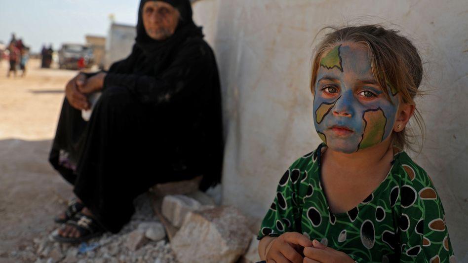Syrisches Mädchen bei einer Covid-19-Infoveranstaltung in einem Camp der Provinz Idlib