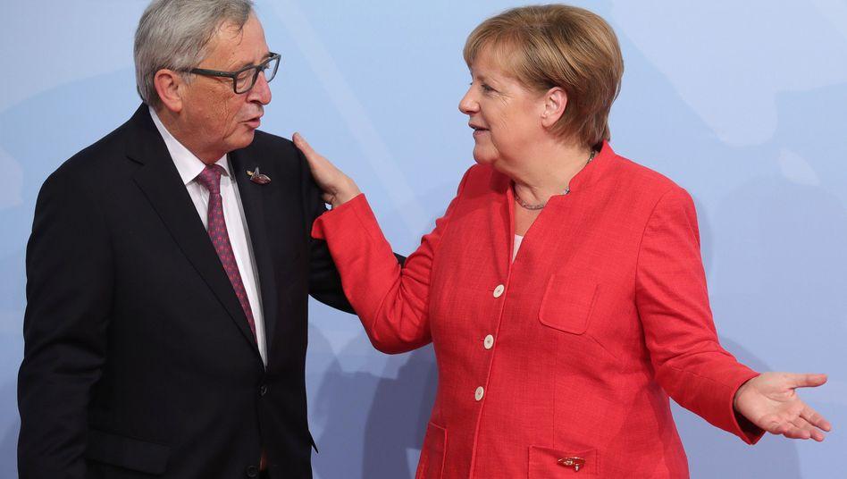 Angela Merkel, Jean-Claude Juncker (im Juli in Hamburg)