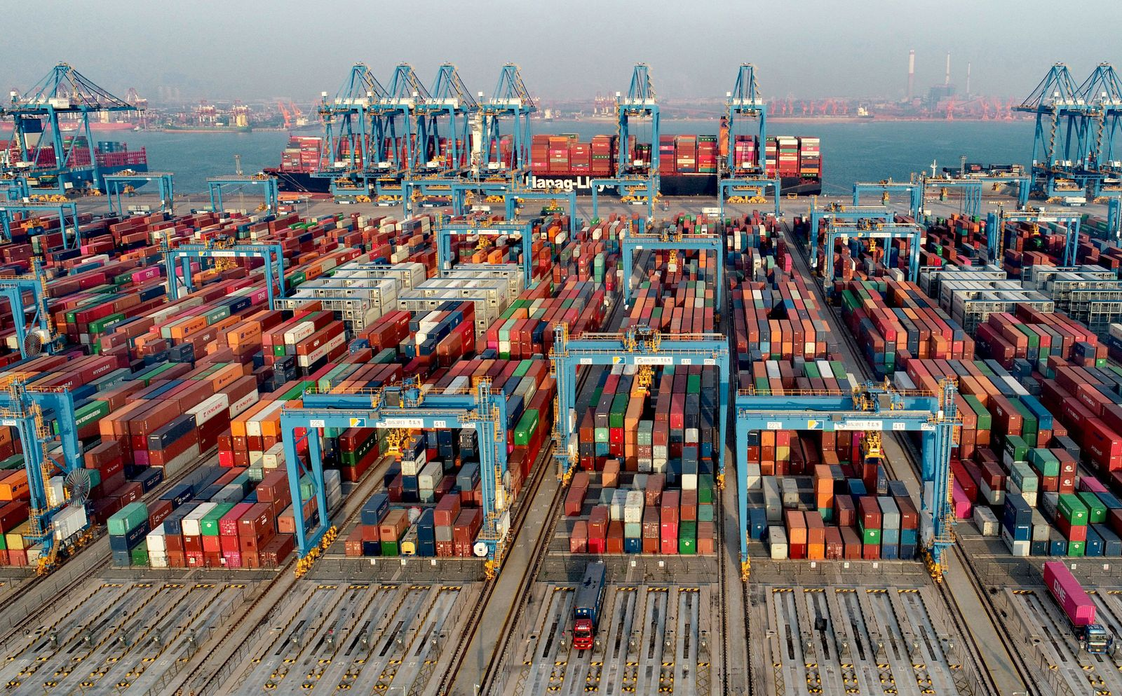 QINGDAO, CHINA - DECEMBER 01: Aerial view of shipping containers sitting stacked at Asia s first fully automated contain