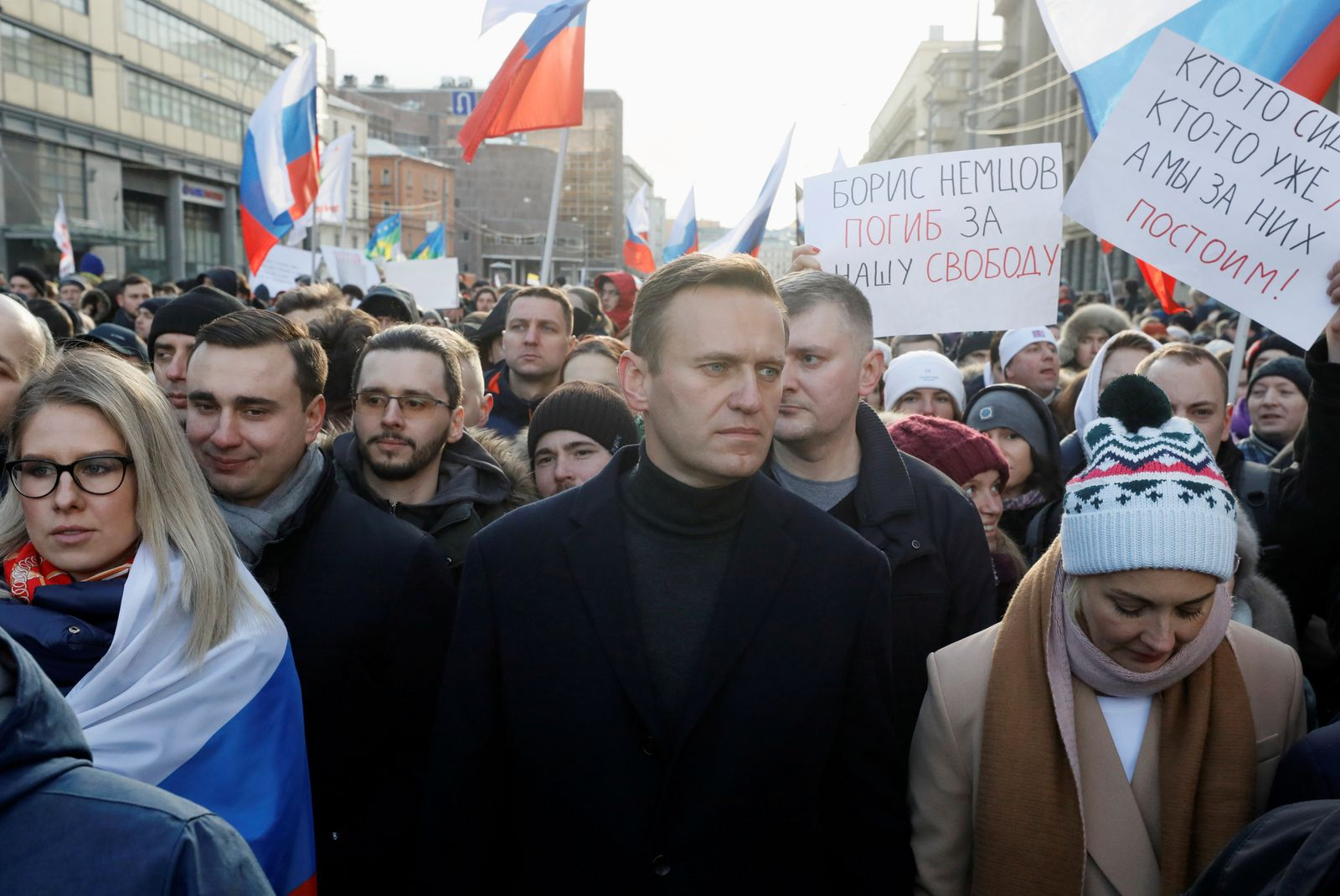 FILE PHOTO: People take part in a rally to mark the 5th anniversary of opposition politician Boris Nemtsov's murder and to protest against proposed amendments to the country's constitution, in Moscow