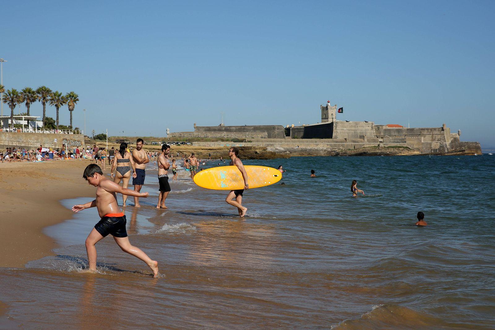 Beachgoers crowd beaches near Lisbon amid COVID-19 pandemic Beachgoers enjoy a summer day at the Carcavelos beach as th