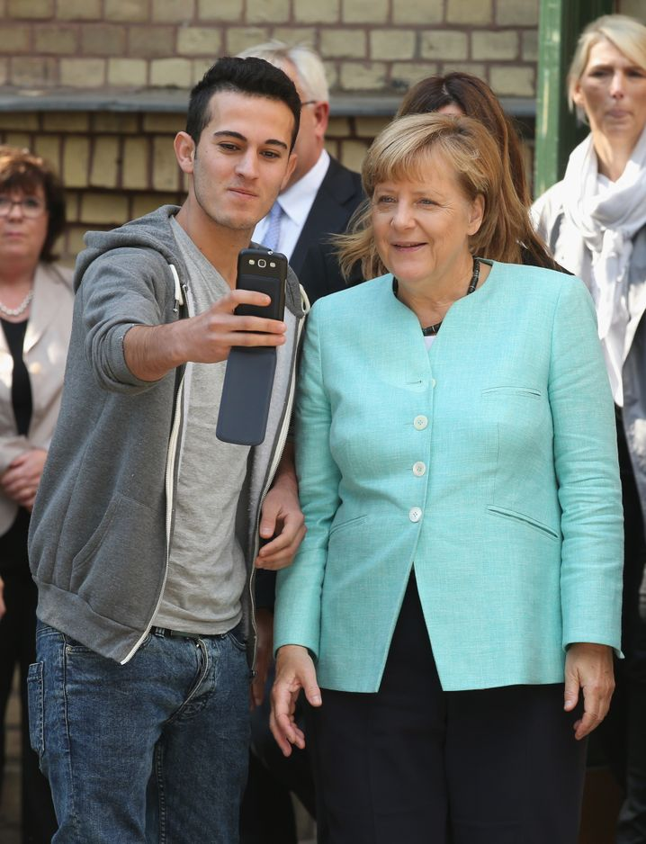 A now iconic Merkel selfie with a refugee