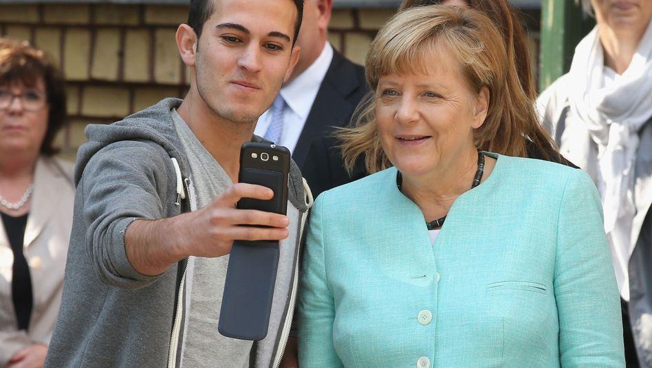 Angela Merkel mit Flüchtlingen in Berlin, September 2015