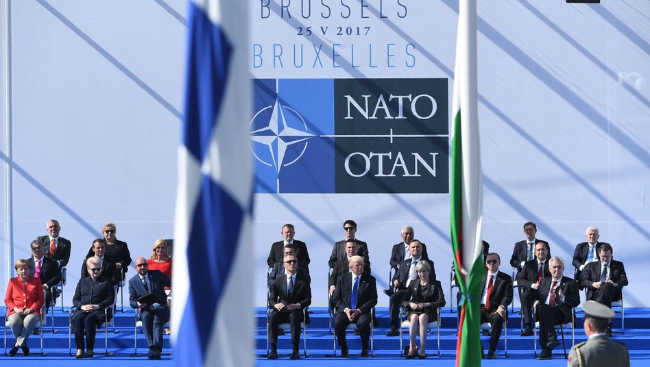 NATO leaders attend a ceremony during the NATO summit in Brussels.