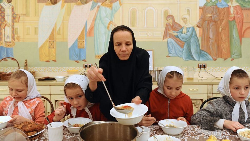 """Children and their caregiver at a Moscow orphanage: """"The worst thing of all is the complete isolation of orphanage children from the outside world."""""""