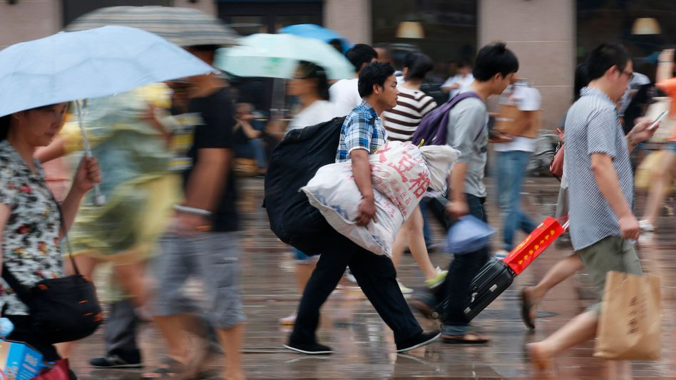 Fußgänger in Peking: Es werden Ungleichgewichte behoben