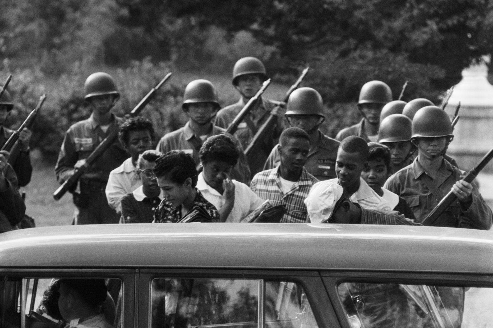 Black Students Leaving School With Troops