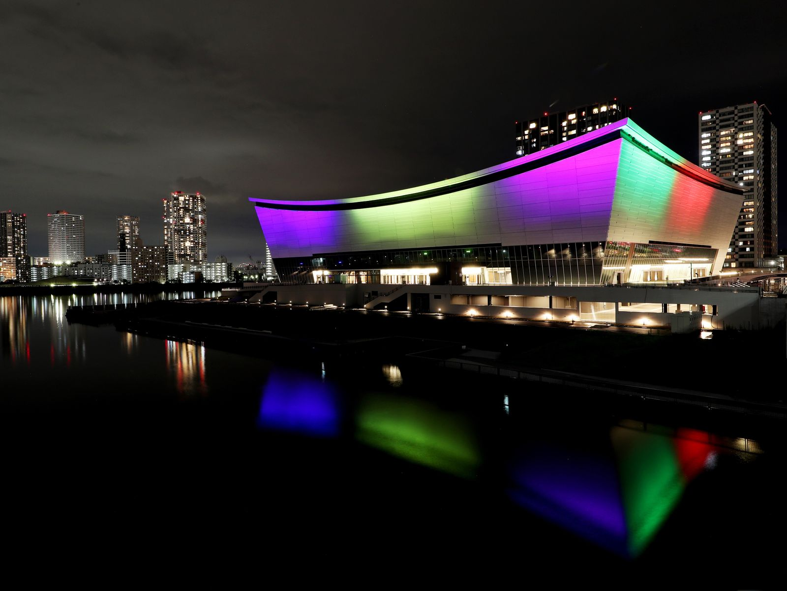 Ariake Arena Is Lit up in Blue and Olympic Symbol Colors