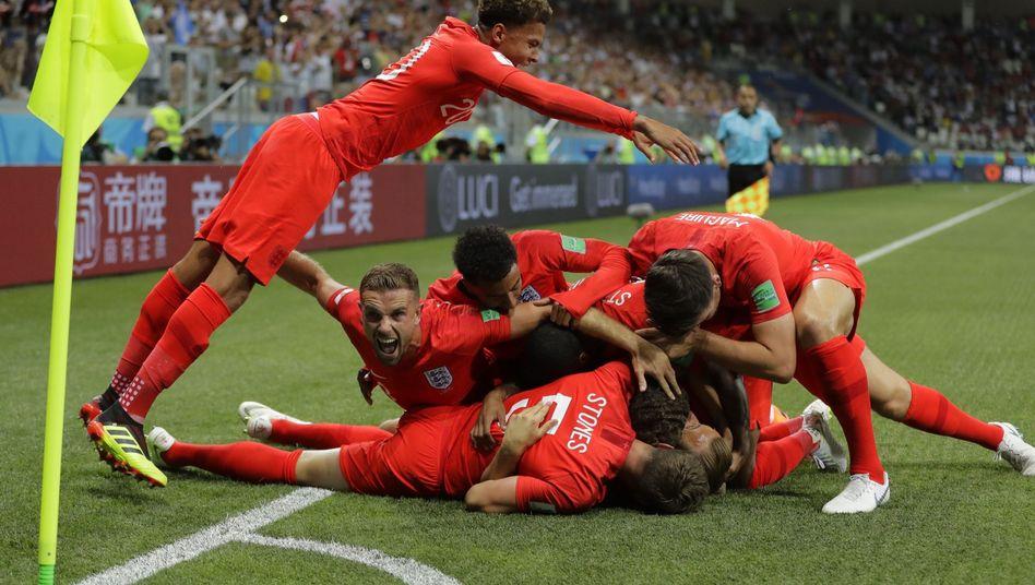 Englands Spieler feiern